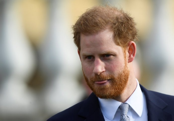 Britain's Prince Harry attends a rugby event at the Buckingham Palace gardens in London. (Reuters Photo)