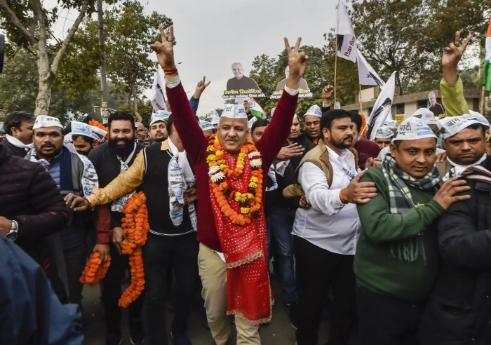 AAP leader and Delhi deputy CM Manish Sisodia along with supporters on his way to file nomination papers from Patparganj Assembly constituency, in New Delhi. (PTI Photo)