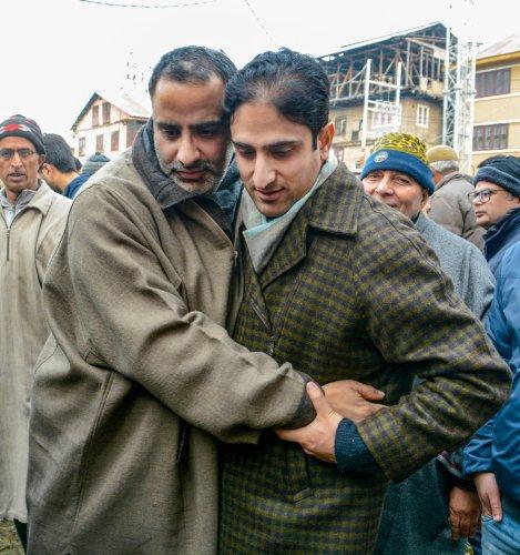 Srinagar Mayor Junaid Matto hugs National Conference Youth President Salman Sagar, who was under detention at a sub-jail since August 5 2019. (PTI Photo)