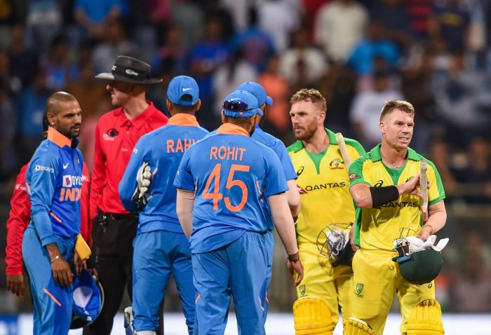 Australian batsman David Warner and Aaron Finch being congratulated by Indian players after they chased down the target to win the first one day international (ODI) cricket match at the Wankhede Stadium in Mumbai. (PTI PHOTO)