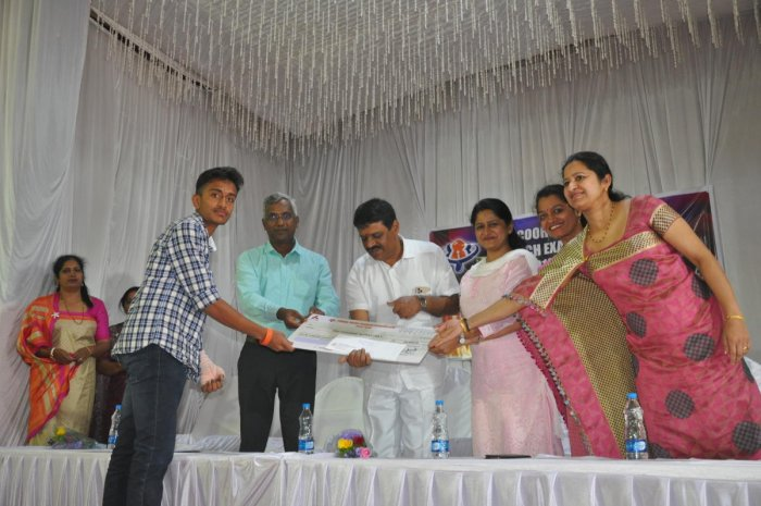One of the topper receives scholarship during Coorg Talent Search Examination, in Madikeri.