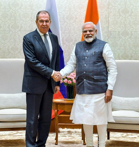 PM Narendra Modi shakes hands with Minister of Foreign Affairs of the Russian Federation Sergey Lavrov during a meeting in New Delhi. (PTI Photo)