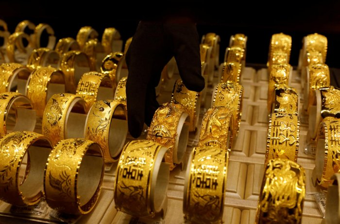 Weighing on gold prices, world stocks scaled record levels on Thursday as investors cheered the trade deal. Credit: Reuters