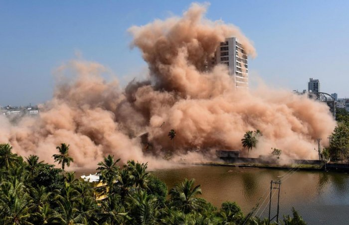 A view of Golden Kayaloram apartment, built in violation of Coastal Regulation Zone norms in Maradu Municipality, being demolished using controlled implosion, in Kochi. (PTI Photo)