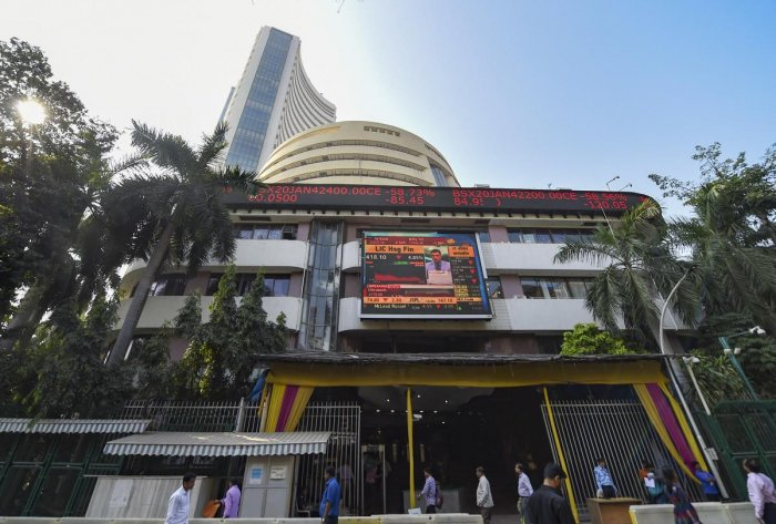 After hitting a record peak of 42,009.94, the 30-share BSE index was trading 127.65 points or 0.30 per cent higher at 42,000.38. Credit: PTI