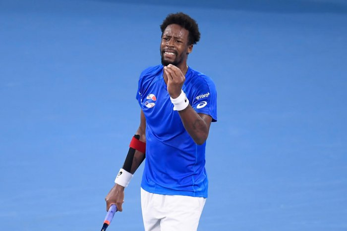 Gael Monfils of France reacts during his match against Novak Djokovic of Serbia during day 4 of the ATP Cup tennis tournament at Pat Rafter Arena in Brisbane, Australia. (AAP Photo)