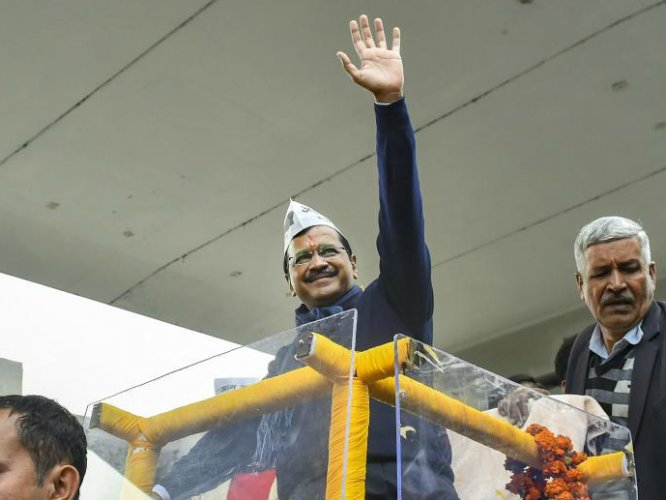 AAP convenor and Delhi Chief Minister Arvind Kejriwal waves from an open vehicle during a roadshow before filing his nomination papers for the Assembly polls, in New Delhi, Monday, Jan. 20, 2020. (PTI Photo)