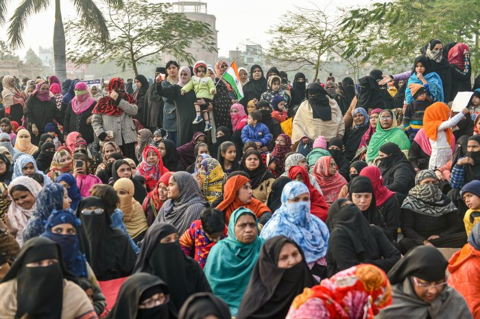 Muslim women along with children stage a protest against CAA and NRC near Ghantaghar in old city area of Lucknow, Monday, Jan. 20, 2020. (PTI Photo)