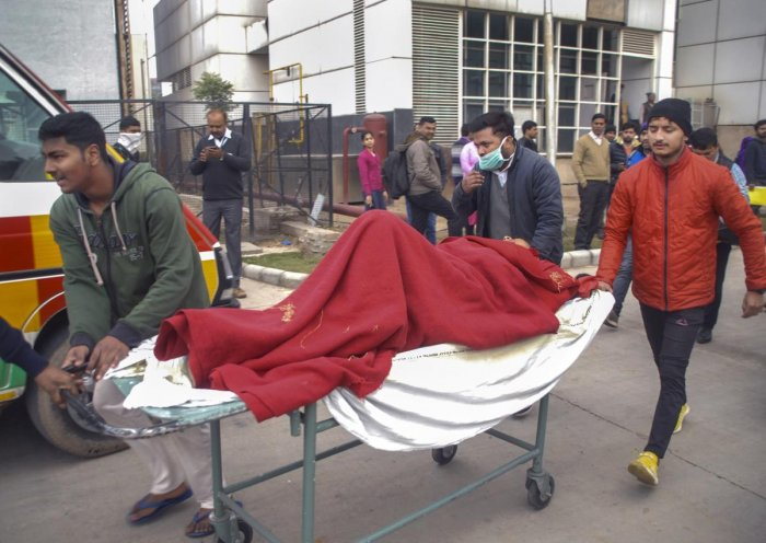 Patients being evacuated from an ESIC hospital, where a fire broke out, in Noida (PTI Photo)