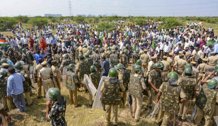 Police stop farmers arriving from various villagers to lay siege the Assembly in protest against the three-capital proposal for state of Andhra Pradesh, at Velagapudi in Guntur district, Monday, Jan. 20, 2020. (PTI Photo)