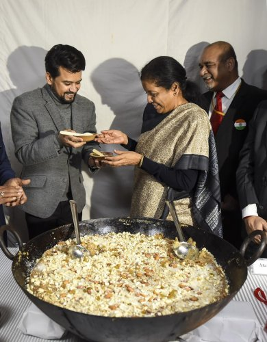 Finance Minister Nirmala Sitharaman(R) and Minister of State for Finance Anurag Singh Thakur(L) during 'Halwa' ceremony marking the commencement of Budget printing process for the General Budget 2019-20, in New Delhi, Monday, Jan. 20, 2020. (PTI Photo)