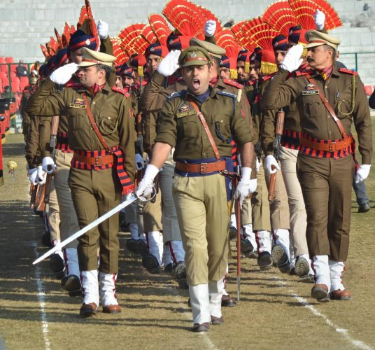 Police contingent marches during the full dress rehearsals for upcoming Republic day parade at Maulana Azad Stadium in Jammu. (PTI Photo)