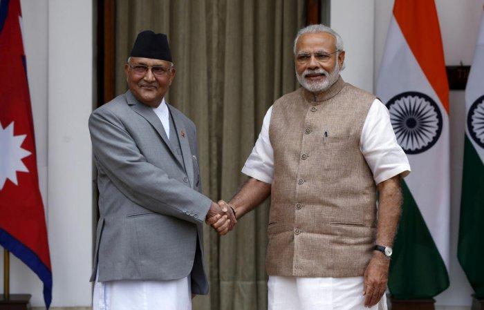 Nepal's Prime Minister Khadga Prasad Sharma Oli with Prime Minister Narendra Modi. (Reuters photo)