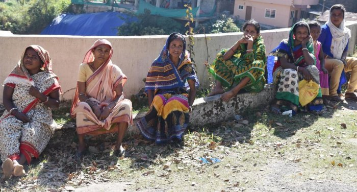 Migrant workers waiting for document verification in Madikeri. DH photo