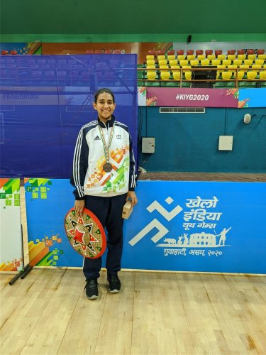 Pavani Sangwan with the bronze medal in the Khelo India Games in Guwahati.