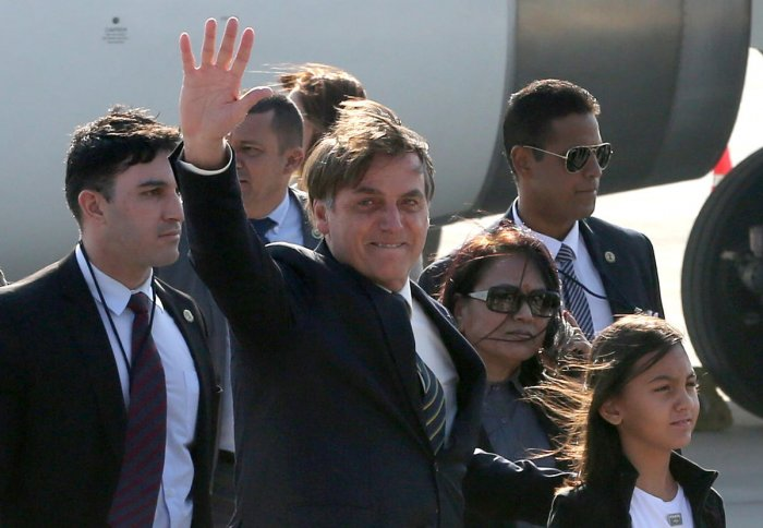 Brazil's President Jair Bolsonaro waves upon his arrival at Air Force Station Palam in New Delhi, India, January 24, 2020. (Reuters Photo)