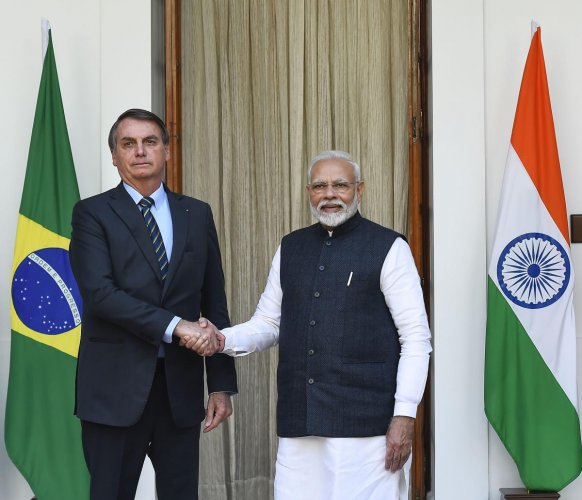 Prime Minister Narendra Modi shakes hands with Brazil's President Jair Messias Bolsonaro prior to a meeting at the Hyderabad House, in New Delhi, Saturday, Jan. 25, 2020. (PTI photo)