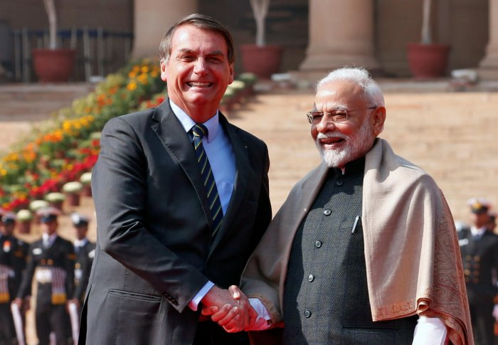 Brazil's President Jair Bolsonaro shakes hands with India's Prime Minister Narendra Modi during his ceremonial reception at the forecourt of India's Rashtrapati Bhavan Presidential Palace in New Delhi, India, January 25, 2020. (Reuters Photo)