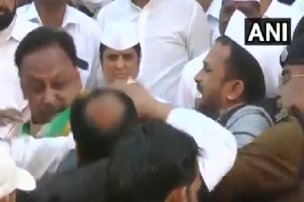 Two Congress leaders get into fight duing Republic Day celebration.