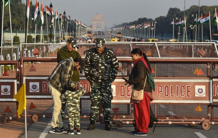 A child, donned in army uniform, interacts with security personnel standing guard at the Rajpath, which is all-set for the Republic Day Parade, in New Delhi, Saturday, Jan. 25, 2020. India is celebrating its 71st Republic Day this year. (PTI Photo)