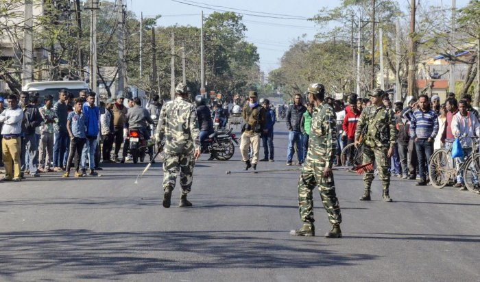 Security forces personnel cordon off the site of blasts which took place at a garbage dumping area at Graham Bazar, in Dibrugarh. (PTI Photo)