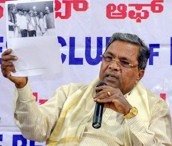 Former Karnataka chief minister Siddaramaiah addresses the press in Bengaluru, Friday, Nov. 1, 2019. (Credit: PTI Photo)