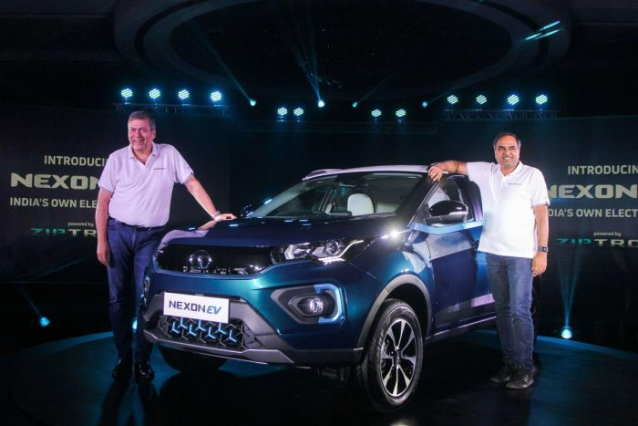 Tata Motors CEO and MD Guenter Butschek and Shailesh Chandra, President of Electric Mobility Business and Corporate Strategy at Tata Motors, unveil Nexon EV Electric SUV, in Mumbai, Thursday, Dec. 19, 2019. (PTI Photo)