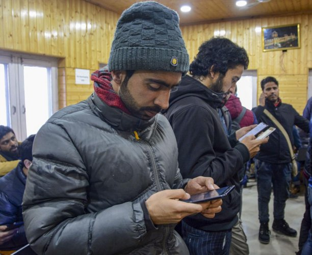 Journalists uses their mobile phone after government had ordered for the restoration of pre-paid mobile services and 2G internet services in 2 districts of the Kashmir valley after the six months of ban, at Government Media Facilitation Centre in Srinagar