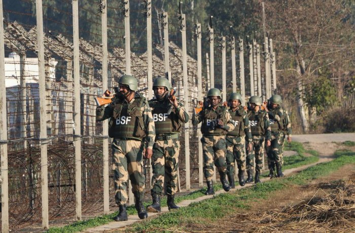 Border Security Force (BSF) soldiers patrol along the India-Pakistan border, ahead of Republic Day 2020 at RS Pura about 35 km from Jammu, Thursday, Jan. 23, 2020. (PTI Photo)