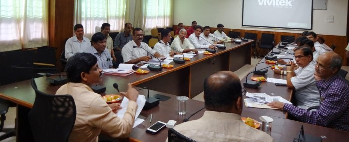 Deputy Commissioner G Jagadeesha chairs a meeting at his ofice in Manipal on Friday.