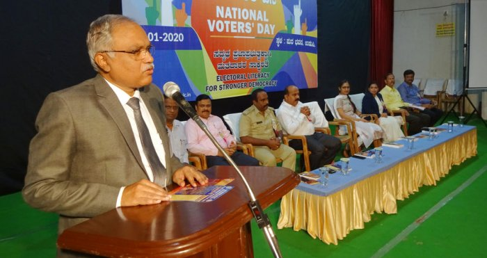 Principal District and Sessions Judge C M Joshi addresses the gathering after inaugurating the National Voters' Day programme at the Town Hall in Ajjarkad in Udupi on Saturday.