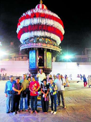 Foreign kite flyers in front of the Kadri temple's chariot during the annual car festival.