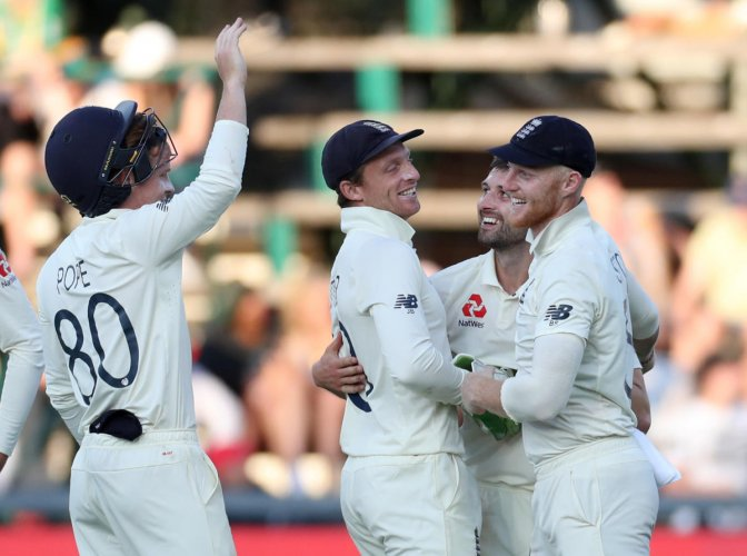 England's Mark Wood celebrates taking the wicket of South Africa's Anrich Nortje. (Reuters Photo)