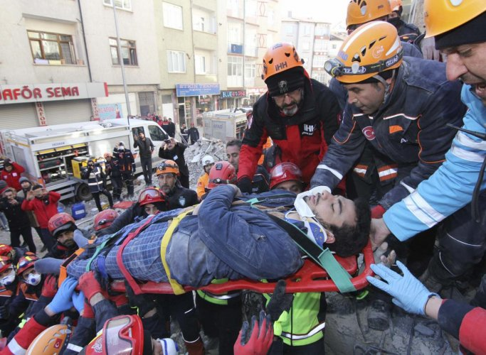 Rescue workers carry a wounded man that was found alive in the rubble of a building destroyed on Friday's earthquake in Elazig, eastern Turkey, Saturday, Jan. 25, 2020. (AP Photo)