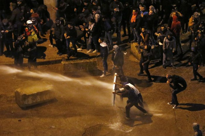 Riot police sprayed anti-government protesters with water cannons as they try to cross to the central government building during ongoing protests in Beirut, Lebanon, Saturday, Jan. 25, 2020. (AP Photo)