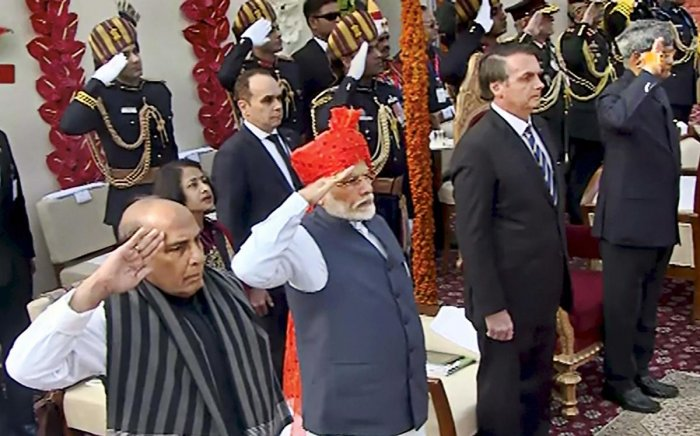 Defence Minister Ram Nath Kovind, Brazilian President Jair Messias Bolsonaro, Prime Minister Narendra Modi and Defence Minister Rajnath Singh stand for the national anthem during the 71st Republic Day celebrations at Rajpath, in New Delhi, Sunday, Jan. 26