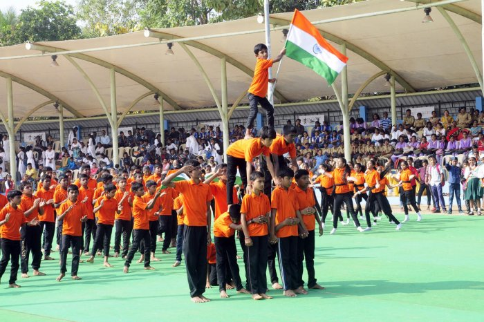 Students present a cultural programme during the 71st Republic Day celebrations at Ajjarakadu district stadium in Udupi on Sunday.