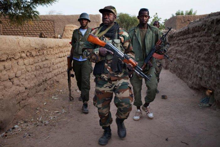 Malian soldiers patrol (Reuters File Photo)