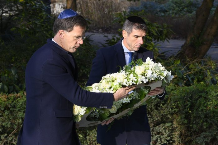 Prime Minister Mark Rutte (L) and State Secretary Paul Blokhuis (Health, Welfare and Sport) lay a wreath at the Auschwitz Never Again monument during during the National Holocaust Remembrance Day in Amsterdam, on 26 January 2020. (Photo by AFP)