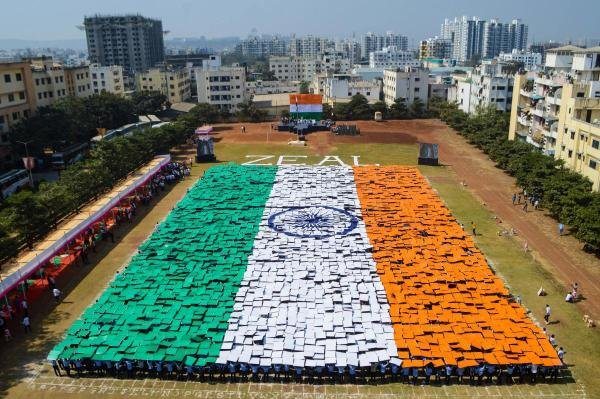 Around 4000 students from Zeal Education Society hold placards to form a huge Indian national flag, in Pune, Maharashtra, Saturday, Jan. 25, 2020. (PTI Photo)