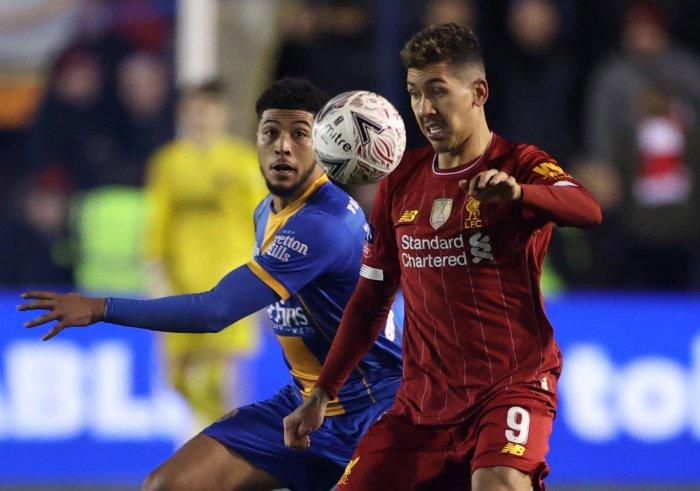 Liverpool's Roberto Firmino in action with Shrewsbury Town's Joshua Laurent. (Reuters Photo)
