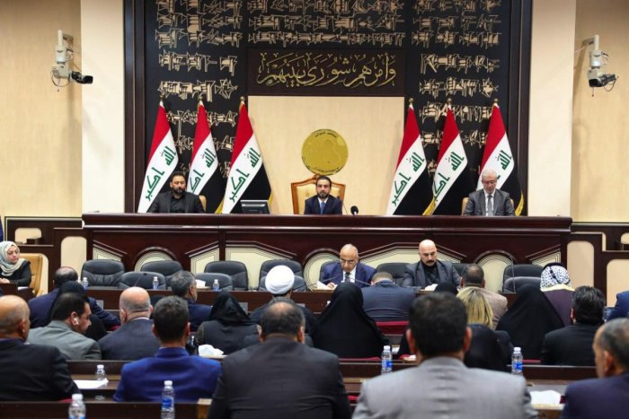 A handout picture released by Iraqi Prime Minister's Media Office on January 5, 2020 shows Iraq's caretaker prime minister Adel Abdul Mahdi (C-down) and Parliament Speaker Mohammed Halbusi (C-up) attending a parliamentary session regarding the ouster of U
