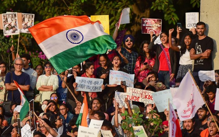 Protesters display placard and raise slogans during a rally against the Citizenship Amendment Act (CAA), National Register of Citizenship (NRC), National Population Register(NPR) and attack on JNU students, in Bengaluru, Monday, Jan. 6, 2020. (PTI Photo)