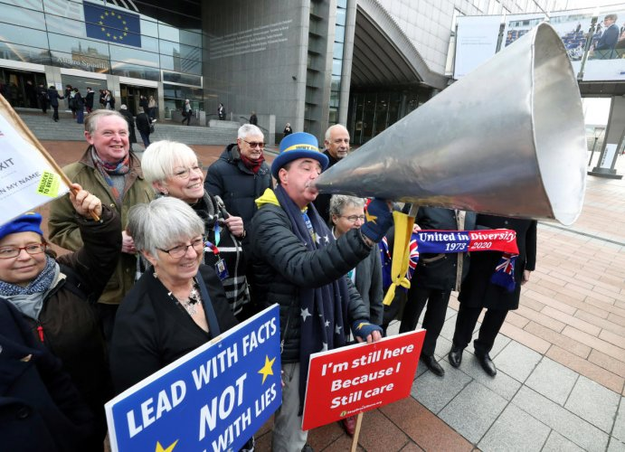 Westminster protester and anti-Brexit activist Steve Bray and members of the European Parliament take part in a protest outside the EU Parliament in Brussels. (Credit: Reuters Photo)