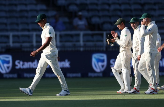 South Africa's Beuran Hendricks walks off the pitch at stumps after taking five wickets on his test debut. Credit: Reuters Photo