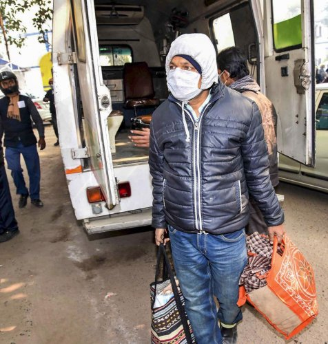 A student who arrived from China, proceeds to Patna Medical College and Hospital for a check-up. (PTI Photo)