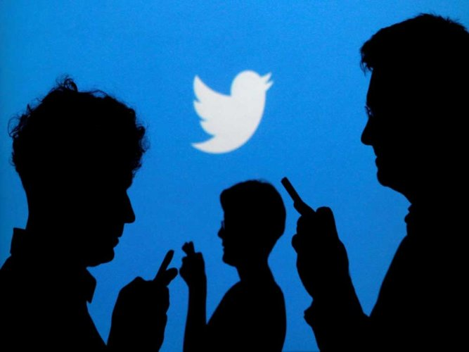 Twitter logo in the background (Credit: Reuters)