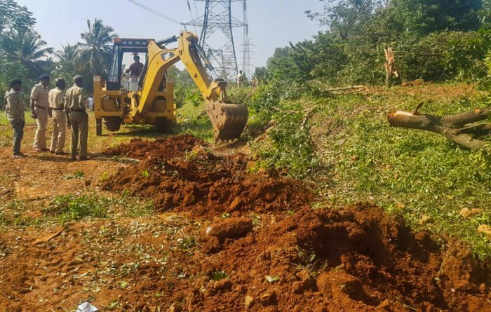 4.10 acres encroached forest land is evicted at Boothanahalli minor forest at Anekal range on Saturday. Land encroached by Corporator.