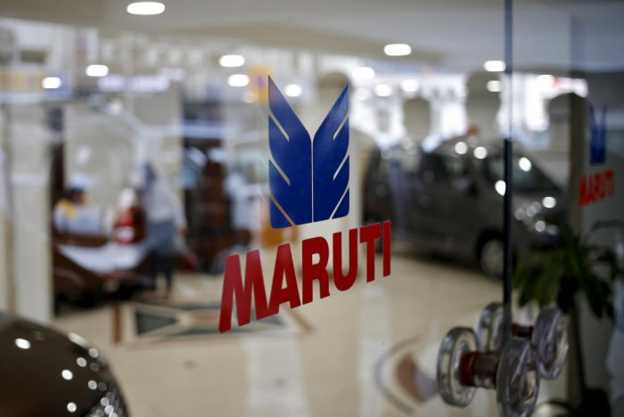The logo of Maruti Suzuki India Limited is seen on a glass door at a showroom in New Delhi, India. (Credit: Reuters Photo)