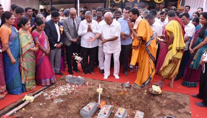 Chief Minister B S Yediyurappa lays foundation stone for the construction of the super speciality hospital on the premises of government maternity hospital in Madikeri on Monday. Deputy Chief Minister Dr Ashwath Naryan and District In-charge Minister V Somanna look on. DH Photo